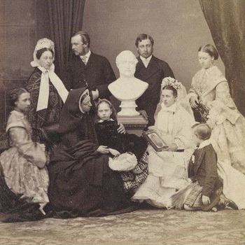Queen Victoria and her children in mourning, seated around a bust of Prince Albert