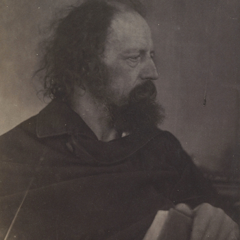 Photograph of Tennyson, half length portrait, head almost profile right. He holds a book in his left hand. 'From Life'. Signed by Tennyson.Julia Margaret Cameron first met Tennyson in London, at the literary salon of her sister Sarah Prinsep. From 1860 sh