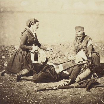 Wounded soldiers in the Crimean War being tended by a nurse